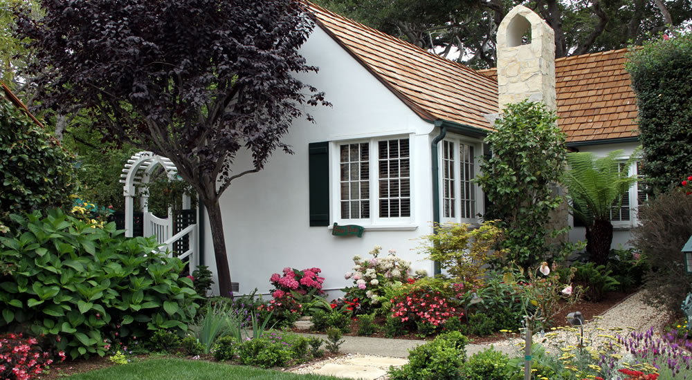 friar tuck cottage in lush gardens