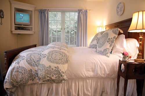 carmel cottages in english gardens - cozy bedroom with TV
