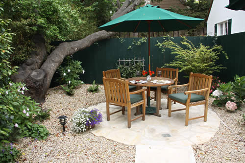 carmel cottages in english gardens - patio with table and chairs